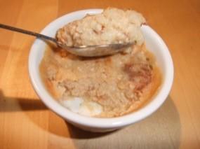 Photo du ramequin de riz au lait dont une cuillère a été prélevée